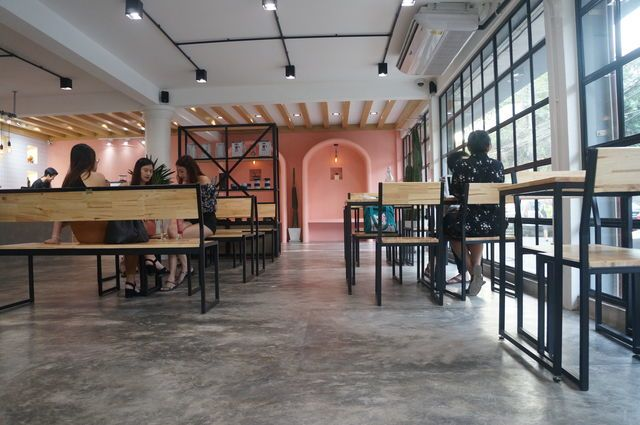 Minimalist design coffee shop with open space and natural light